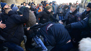 Demonstrators clash with police during a rally in support of jailed opposition leader Alexei Navalny in the far eastern city of Vladivostok on January 23, 2021.