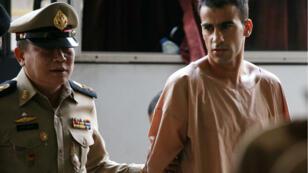 اللاعب العريبي أثناء تقديمه للمحاكمة