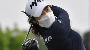 South Korean golfer Cho Jeong-min played wearing a facemask
