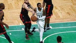Boston's Kyrie Irving drives to the basket in overtime of the Celtics' 123-116 NBA victory over the Toronto Raptors