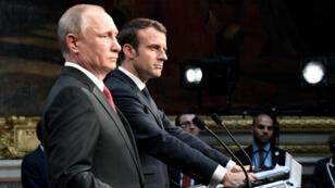 Emmanuel Macron et Vladimir Poutine lors de leur conférence de presse commune, le 29 mai.