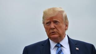 Donald Trump s'adressant à la presse à l'aéroport de Morristown, New Jersey, le 13 août 2019.