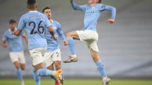 Manchester City midfielder Phil Foden (right) celebrates scoring against Brighton