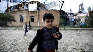 Bahtiyar Elnur, 5, who was injured during a blast, plays with his sister Sehla, during the fighting over the breakaway region of Nagorno-Karabakh in the city of Ganja, Azerbaijan October 11, 2020.