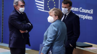 European Parliament President David Sassoli (L) speaks with Germany's Chancellor Angela Merkel (C) and France's President Emmanuel Macron (R) in Brussels, Belgium on October 15, 2020.