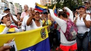 متظاهرون مؤيدون لزعيم المعارضة خوان غوايدو في العاصمة الفنزويلية كراكاس، 9 مارس/ آذار.