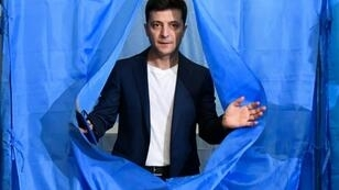Zelensky has called on officials not to hang his photographs in their offices
