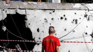 Un mur criblé d'impacts de tirs de roquettes dans la ville d'Ashkelon, en Israël, le 13 novembre 2018.