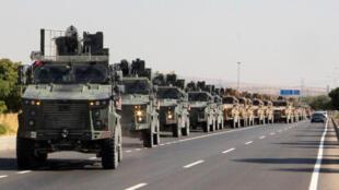 عربات عسكرية تركية تتقدم نحو الحدود السورية. 9 أكتوبر/تشرين الأول 2019.