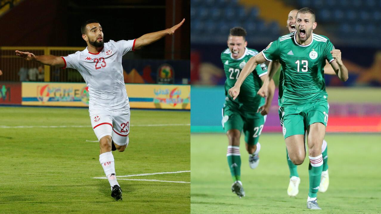 Naim Sliti, de Túnez, e Islam Slimani, de Argelia, celebran durante los partidos de cuartos de final de la Copa Africana de Naciones en Egipto, el 11 de julio de 2019.