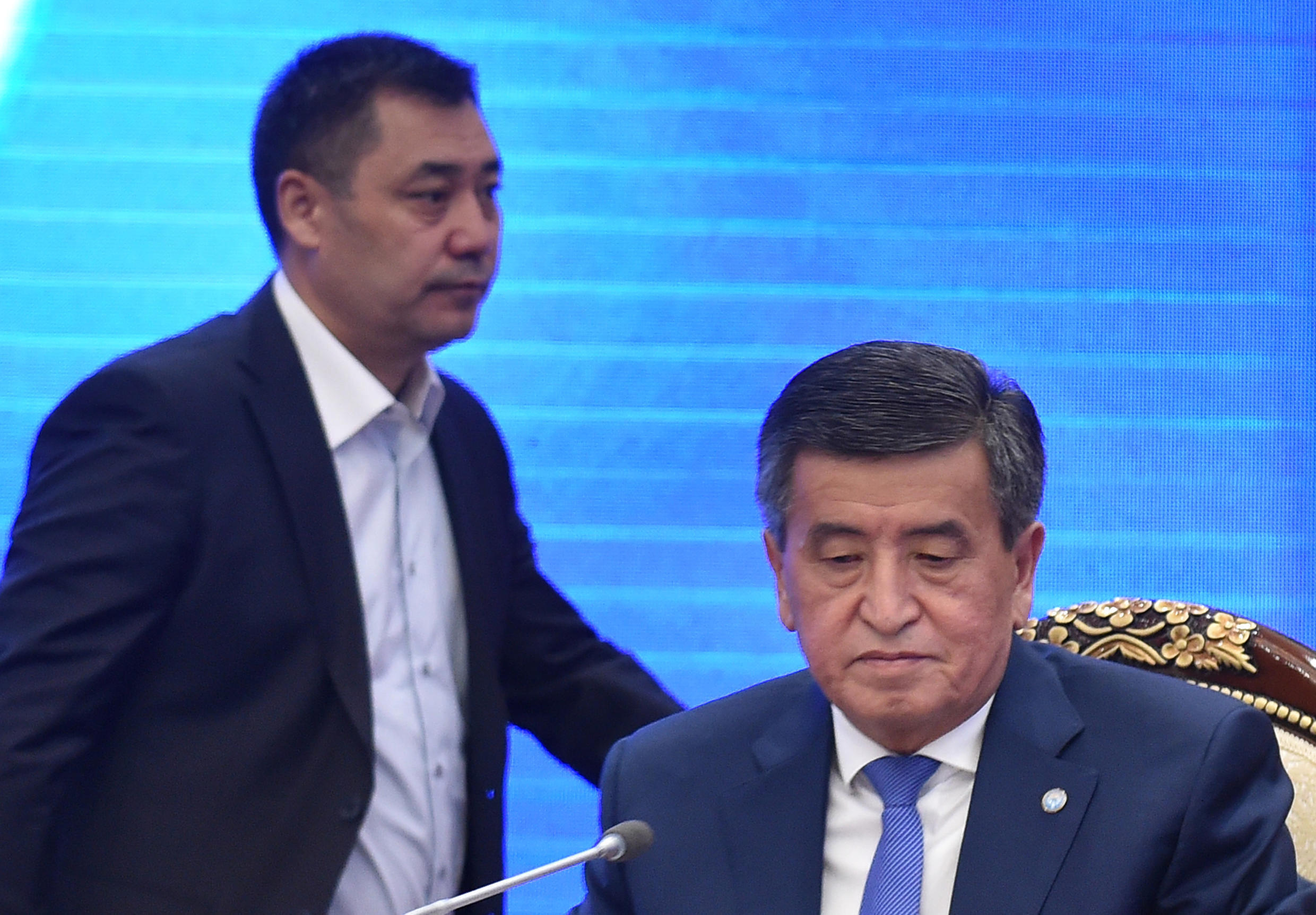 Power is currently in the hands of prime minister and acting president Sadyr Japarov (left) after Sooronbay Jeenbekov (right) stepped down following a disputed vote