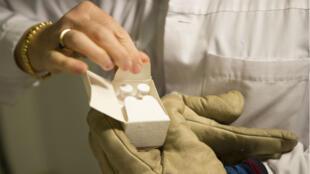 A batch of experimental rVSV Ebola vaccine arrives at the Geneva University Hospital, Switzerland on October 22, 2014