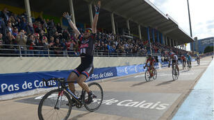 Team Giant-Alpecin German cyclist John Degenkolb celebrates after winning the 113th edition of the Paris-Roubaix one-day classic cycling race on April 12, 2015.
