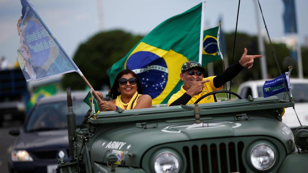 Des soutiens de Jair Bolsonaro, favori de la présidentielle brésilienne, ont participé à un rassemblement le 27 octobre 2018.