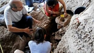 Archaeologists inspect what they believe is the world's oldest site for alcohol production, south of the Israeli city of Haifa in cave dating back 13,000 years