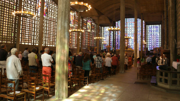 Congregants attend an interfaith mass in the northern Paris suburb of Raincy on Sunday following the grisly murder of an 86-year-old priest earlier this week.