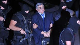 File photo taken October 2, 2013 of  leader of Greek neo-Nazi party Golden Dawn Nikos Michaloliakos arriving at an Athens court.