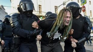Russian special police forces were deployed to detain protesters following a rally for fair elections in central Moscow