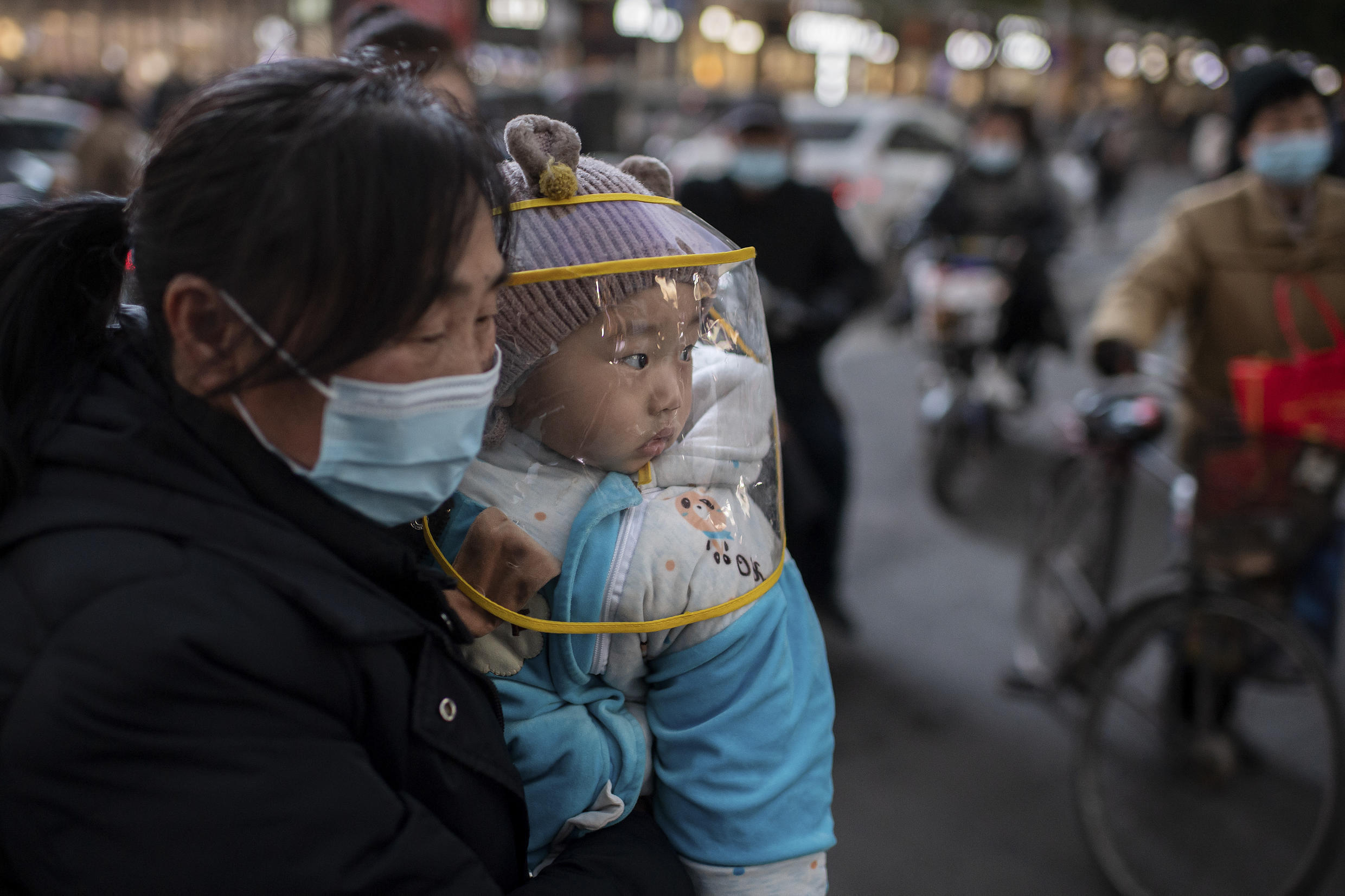 A woman and her child near a shopping mall in Wuhan, China, on January 13, 2021.