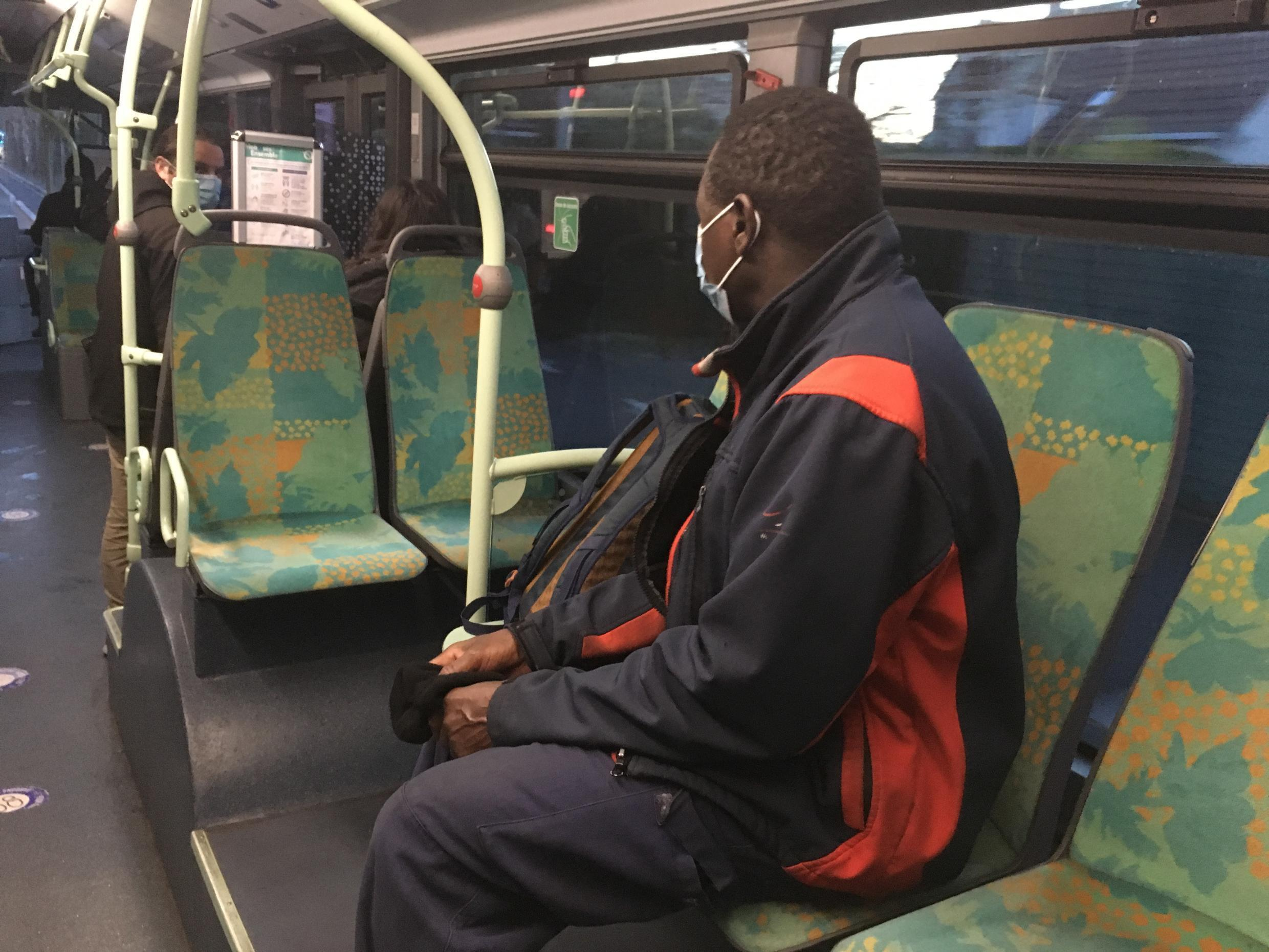 Moussa, a forklift operator and regular passenger on bus route 351.