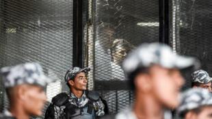 Le photojournaliste égyptien Mahmoud Abouzied lors de son procès au Caire, le 28 juillet 2018.