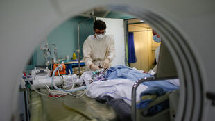 A patient suffering from Covid-19 is treated in the Intensive Care Unit (ICU) at the Robert Ballanger hospital in Aulnay-sous-Bois near Paris on May 6, 2020.