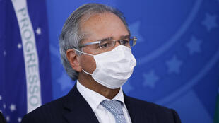 "Brazil's Economy Minister Paulo Guedes -- seen here in March 2020 -- has warned of a possible ""economic collapse"" because of stay-at-home measures designed to curb the spread of the novel coronavirus"