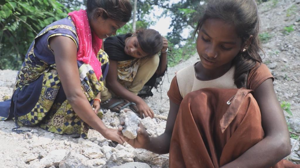 In Jharkhand, one of India's poorest States, children picking mica. Child labour is still one of the main sources of mica production, a mineral coveted by many industries for its alluring sparkle.