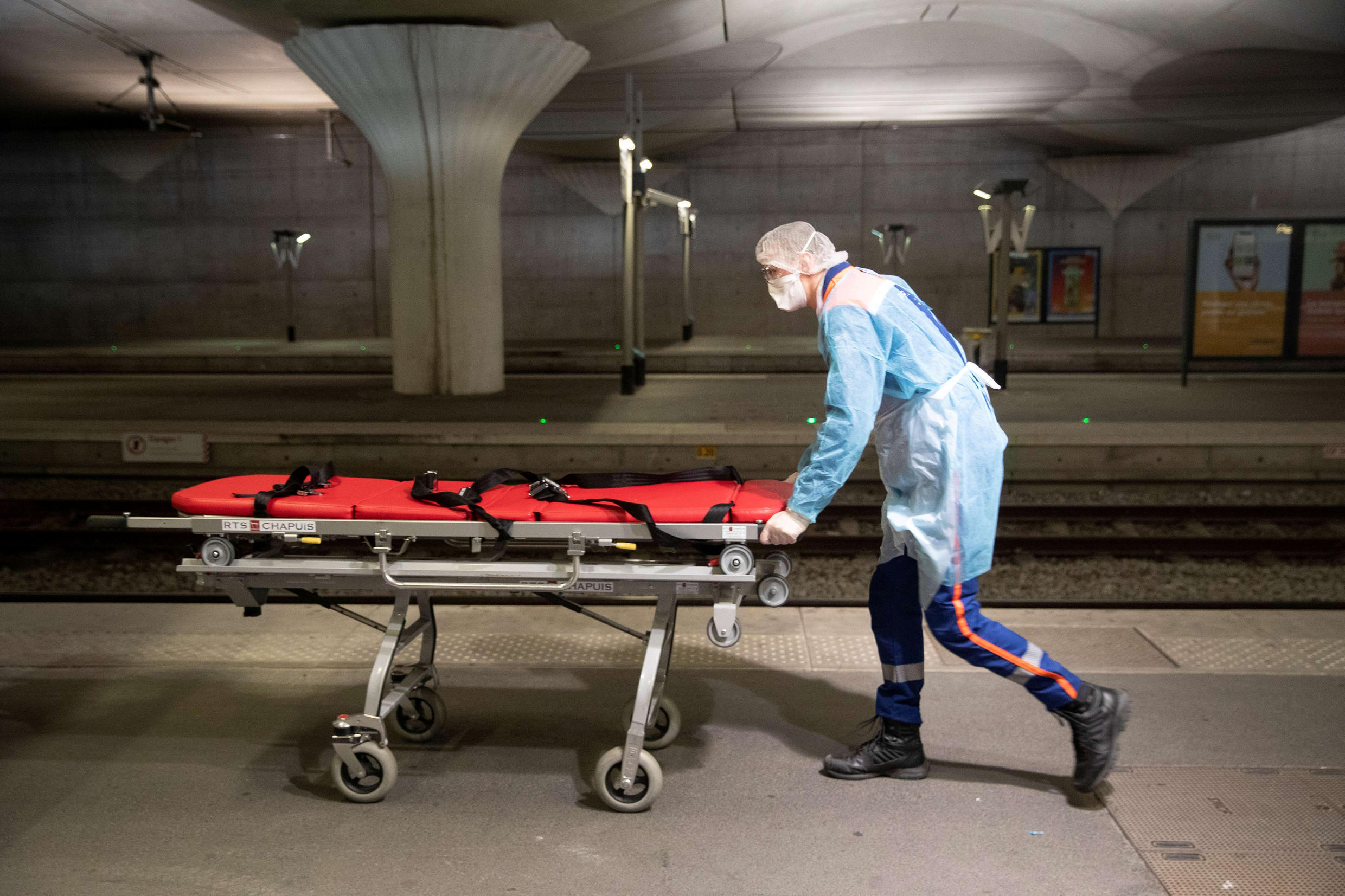 A medical staff member pushes a stretcher on a platform at the Gare d'Austerlitz train station as the spread of the coronavirus disease continues in Paris, France on April 1, 2020.