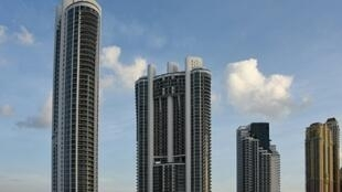 Under the shadow of luxury skyscrapers -- among them Trump Towers, seen here -- Sunny Isles Beach has become a prized destination for well-off foreigners looking to secure US citizenship for their children