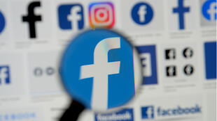 : Facebook logos are seen on a screen in this picture illustration taken December 2, 2019.