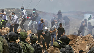 Palestinian demonstrators and Israeli forces clash in July 2020 near the West Bank city of Nablus over the Jewish state's controversial annexation proposal