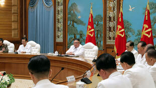 """North Korean leader Kim Jong Un convened an emergency politburo meeting on Saturday to implement a """"maximum emergency system and issue a top-class alert"""" to contain the virus, official news agency KCNA said"""