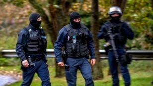French police arrested three in a dawn raid on the Zahra Centre religious association at Grande Synthe near Dunkirk, one of France's biggest Shiite centres, citing terror prevention