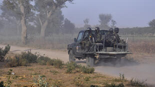 Cameroon troops patrol on the outskirts of Mosogo in the far north of the country, where Boko Haram jihadists have been active since 2013.