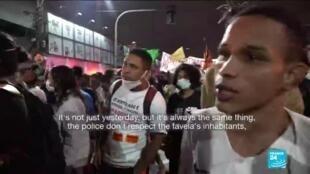 A protester denounces police violence in Rio de Janeiro.