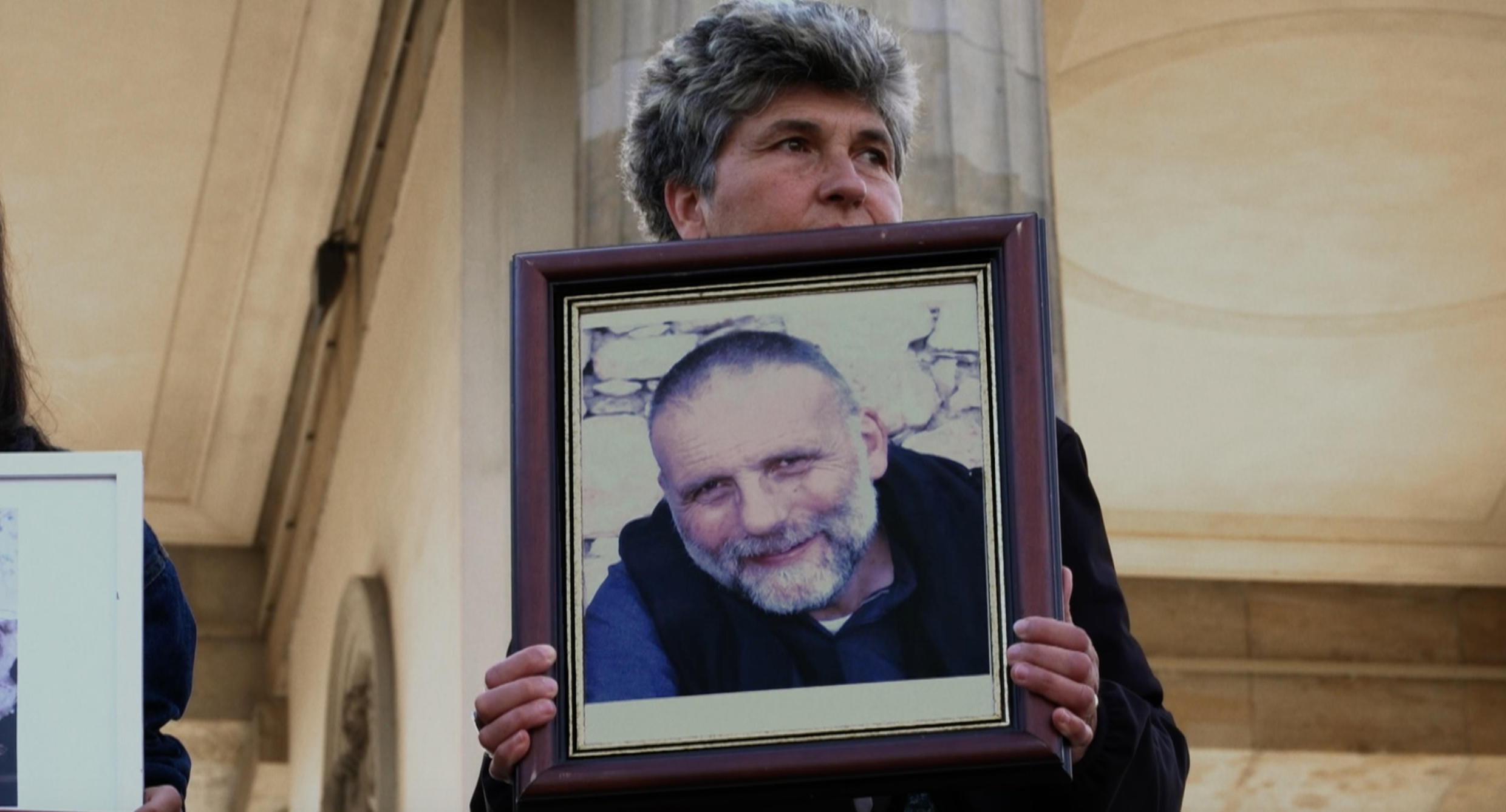 """""Machi"" Dall'Oglio holds a photo of his brother, Father Paolo Dall'Oglio, kidnapped in Syria in 2013 by the Islamic State group and missing ever since."