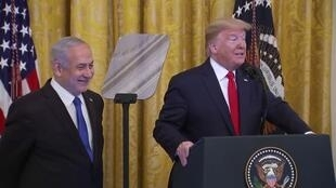 US President Donald Trump alongside Israeli PM Benjamin Netanyahu as Trump unveils his Middle East peace plan, January 28 2020/
