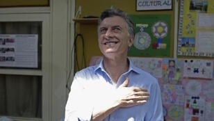 Buenos Aires mayor Mauricio Macri prepares to cast his vote in the presidential runoff, which exit polls now suggest he has won, at a polling station in Buenos Aires on November 22, 2015.