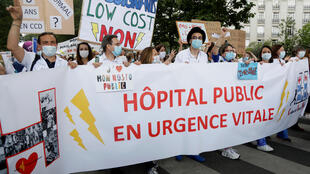 Healthcare workers protest in Paris on June 16, 2020.