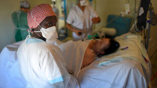 A nurse tends to a Covid-19 patient at the Estrée clinic in Stains, north of Paris.