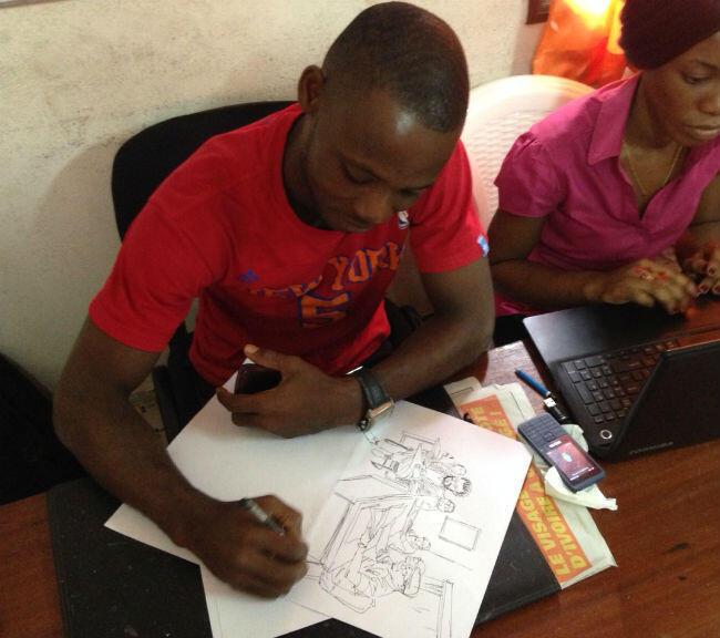 Le dessinateur Seraye croquant la conférence de rédaction.