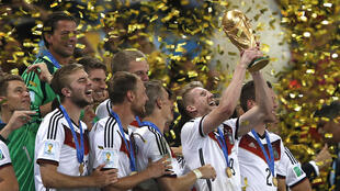 Andre Schuerrle (C), seen here winning the 2014 World Cup with Germany, has announced his retirement from football on Friday at the age of just 29.