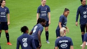 France captain Amandine Henry (C) with teammates at a training session on Thursday as they prepared for their World Cup opener against South Korea
