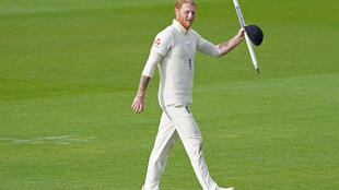 Main man - England's Ben Stokes holds a souvenir stump after starring with both bat and ball in the West Indies win