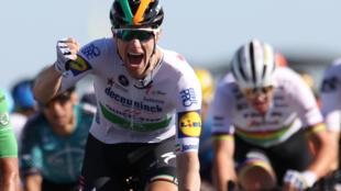 Sam Bennett celebrates as he crosses the finish line