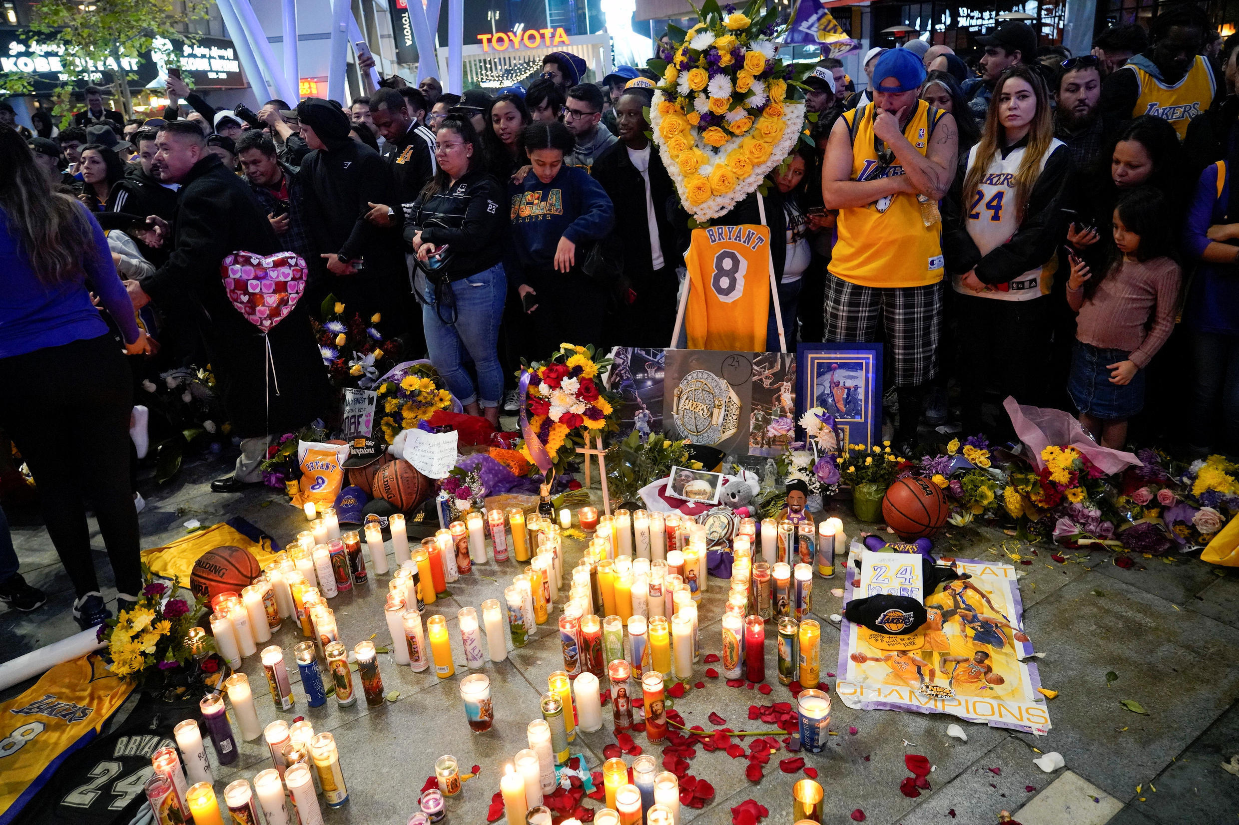Mourners gather in Microsoft Square near the Staples Center in Los Angeles, California, to pay respects to Kobe Bryant after the retired basketball star was killed in a helicopter crash on January 26, 2020.
