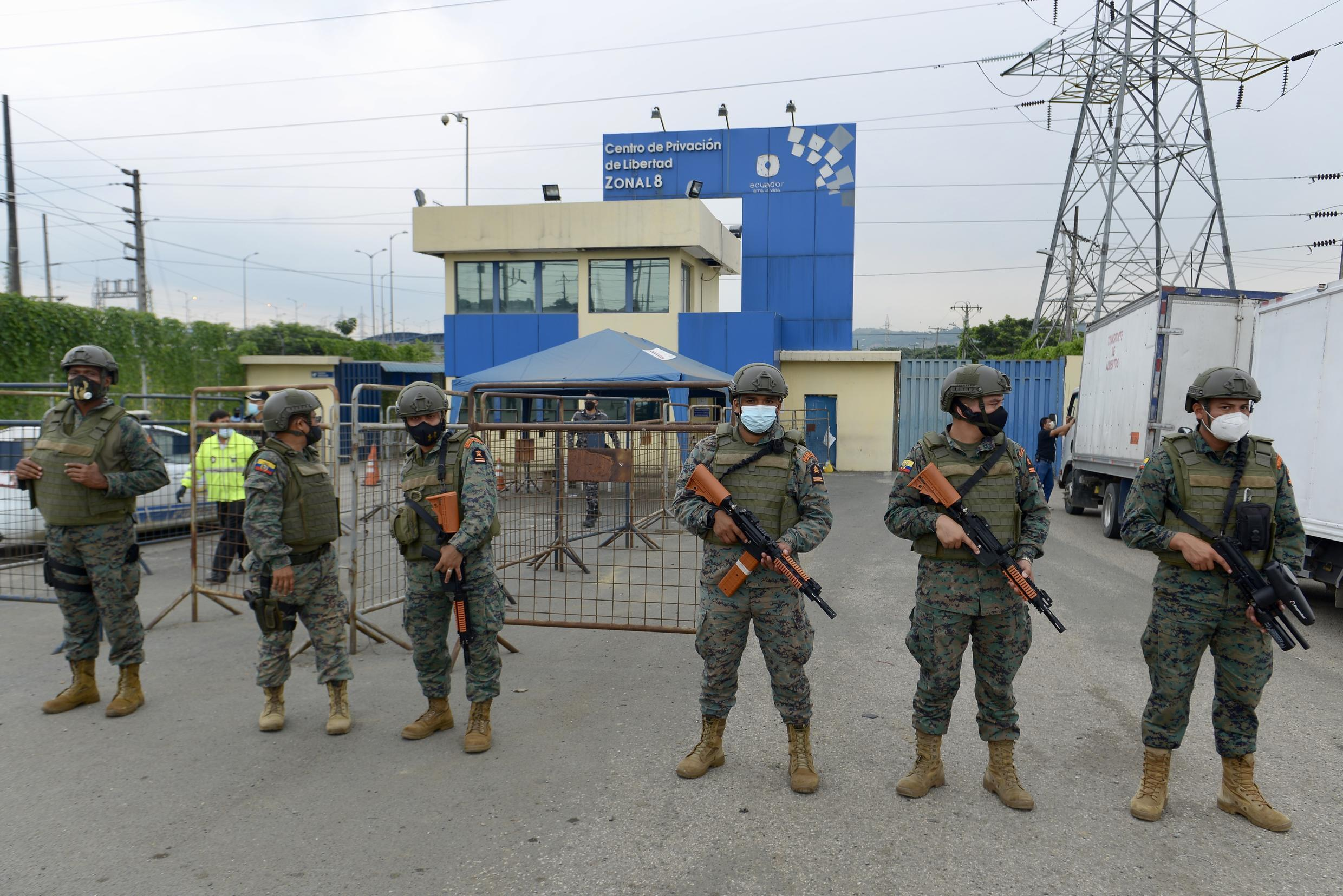 Security forces guard a prison in Ecuador, where dozens of inmates died in riots