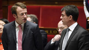 French Economy and Industry Minister Emmanuel Macron (L) with Prime Minister Manuel Valls  at the French National Assembly