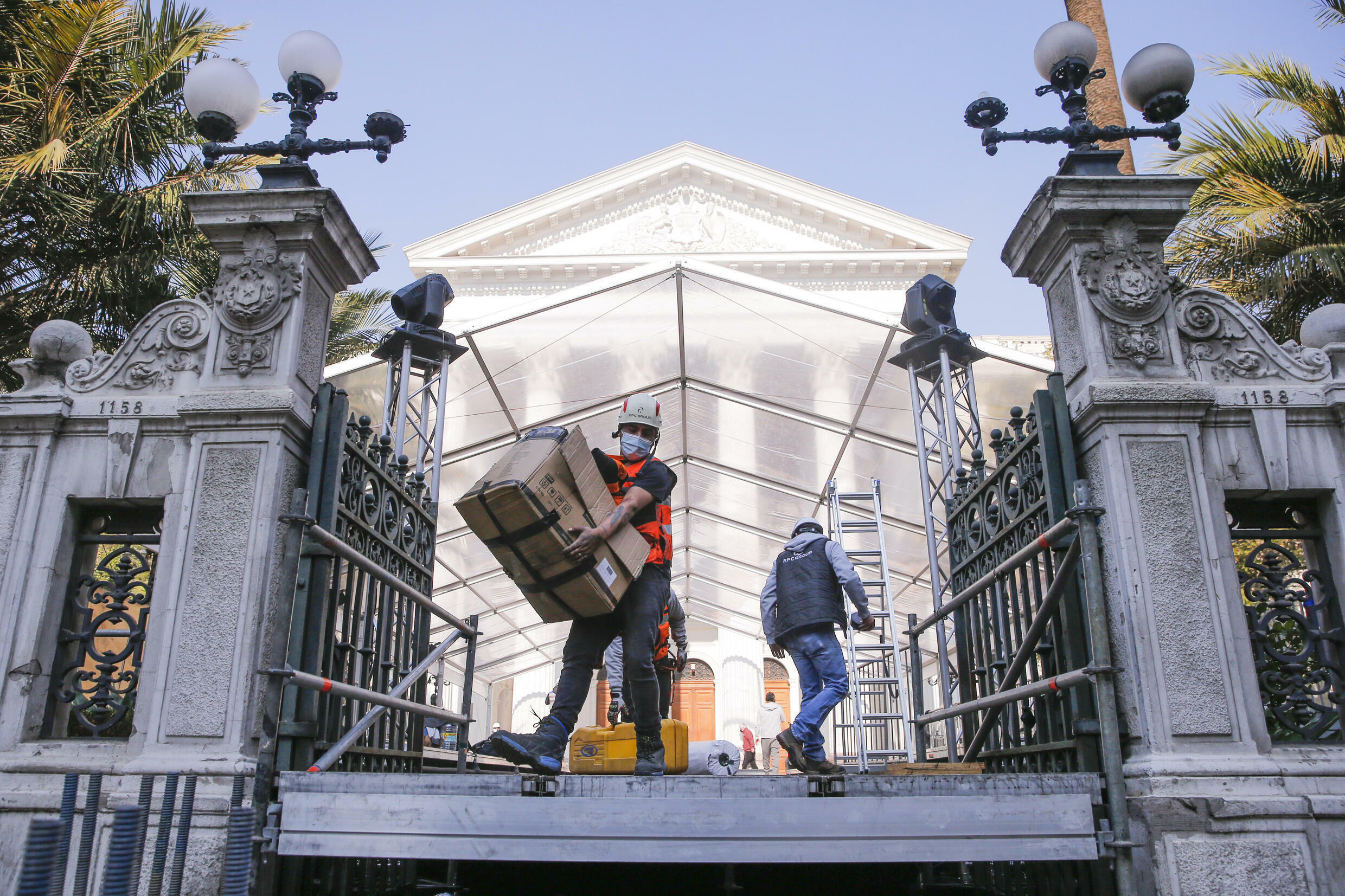 Workers in Chile prepare the National Congress headquarters before an elected assembly meets to draft the country's new Constitution
